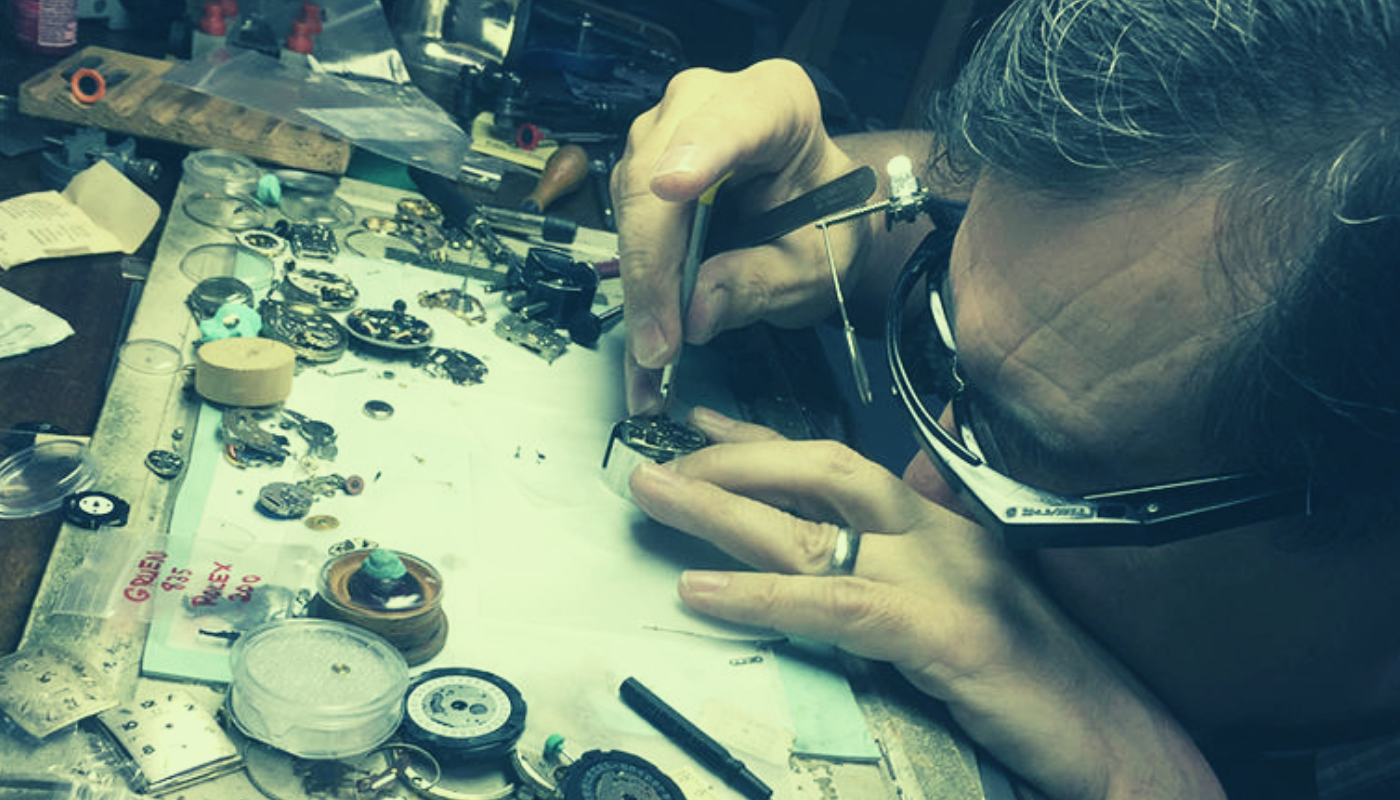 Watchmaker making a watch